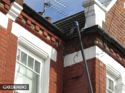 Expert gutter cleaning in action